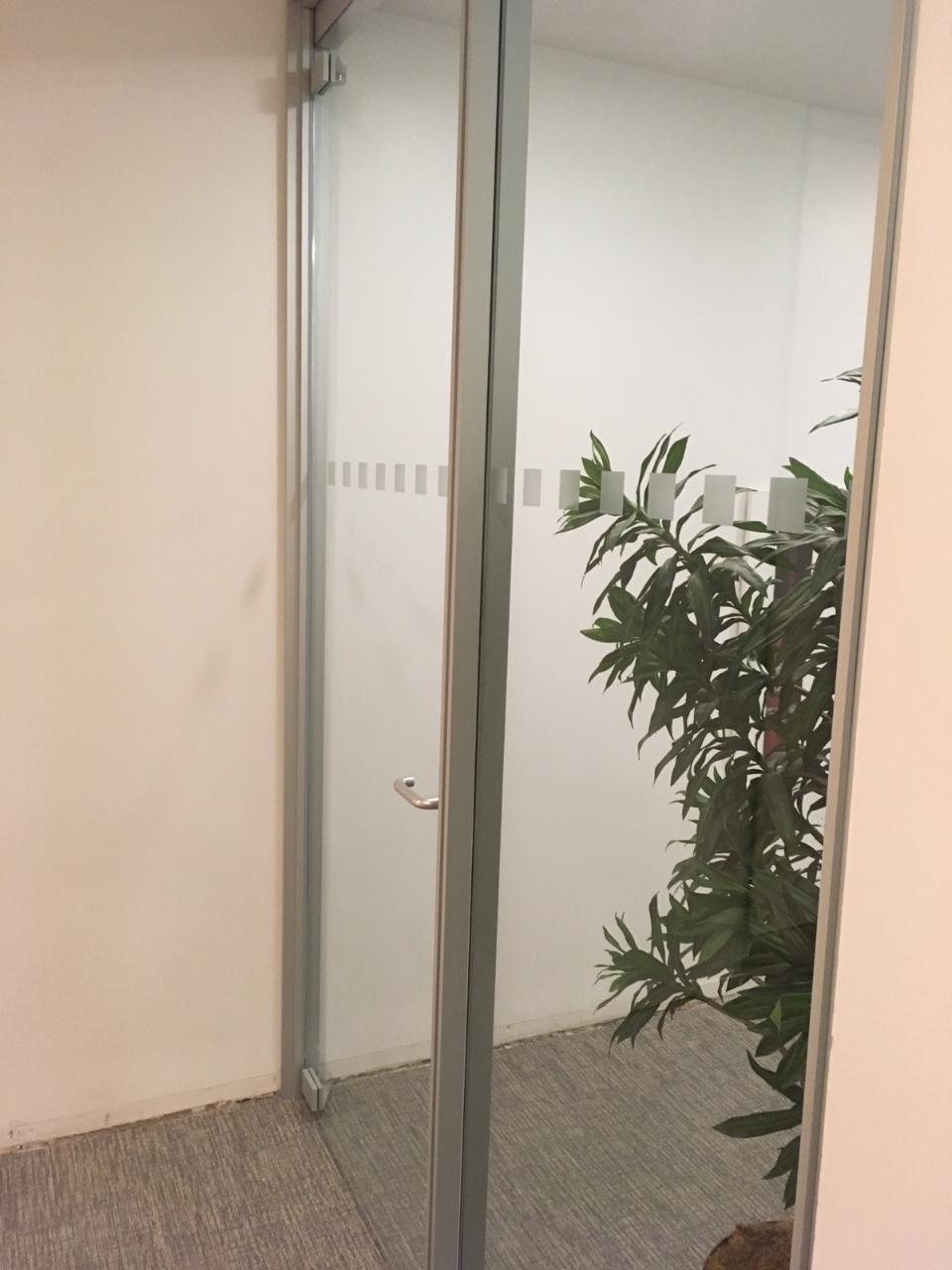 Clear window film with small white squares