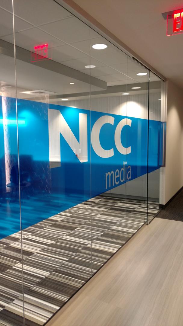 NCC Media printed on office window